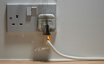 image of a socket on fire